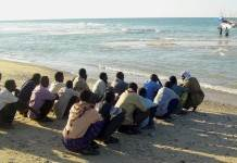 Illegal Immigrants From Somalia Wait Before Boarding A Vessel In The Port Town Of Bossaso